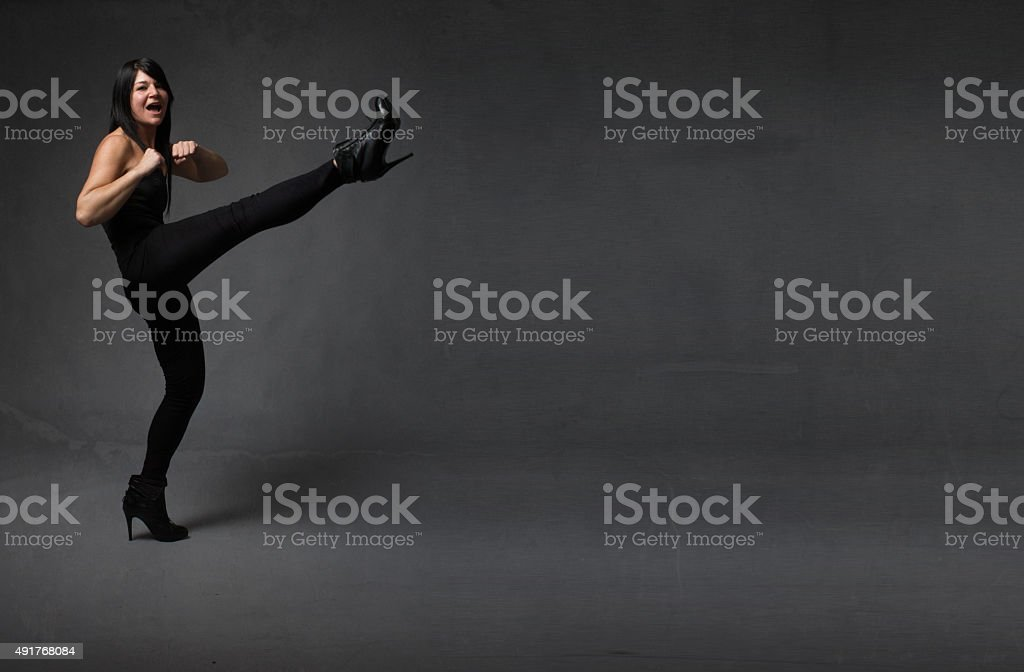 woman kicking empty space stock photo