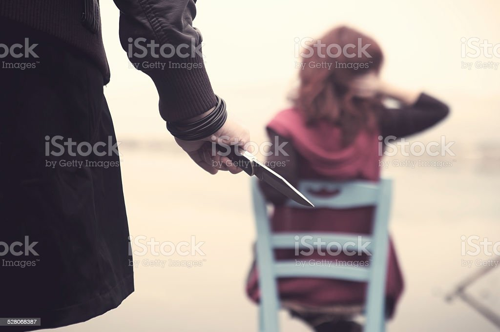 Woman killer with knife stock photo