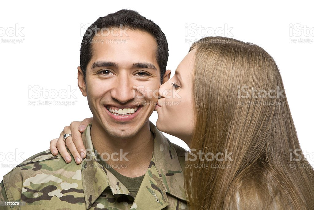Woman Kisses Latino Serviceman on the Cheek royalty-free stock photo