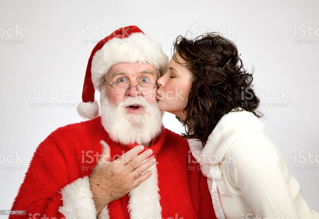 Woman Kissing Santa royalty-free stock photo