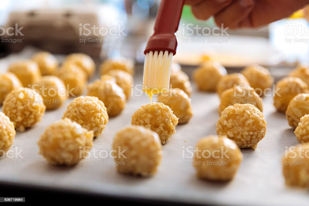 Woman kneading marzipan for make panellets. stock photo
