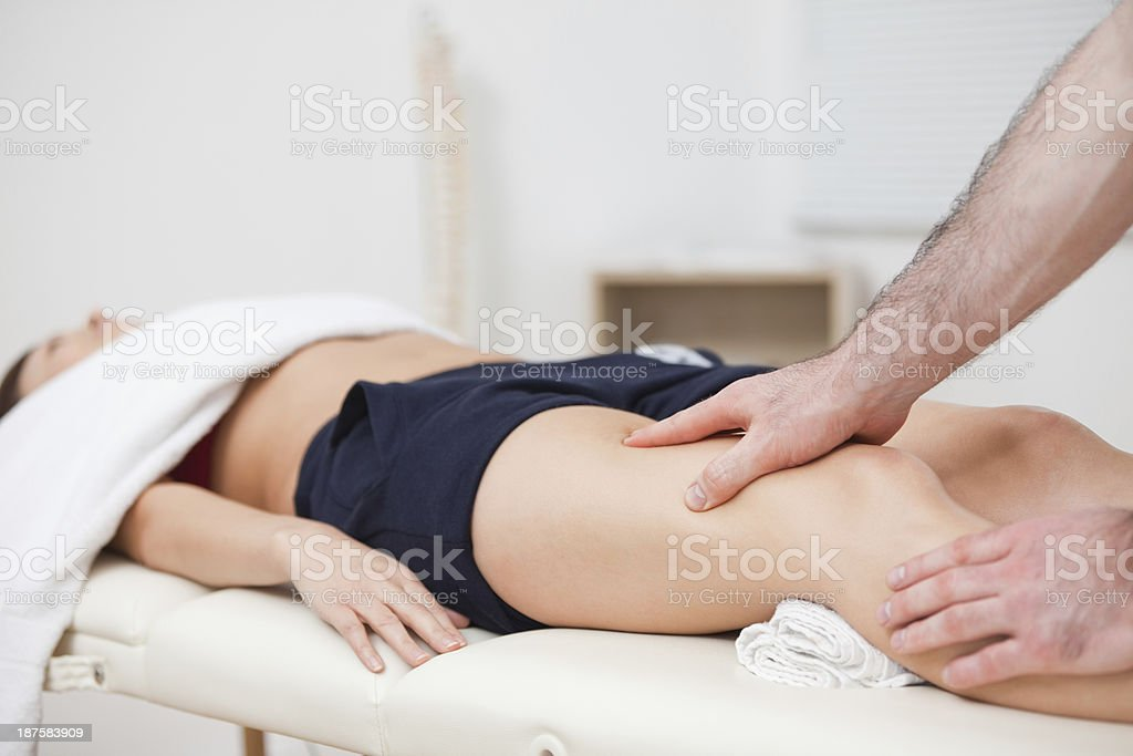 Woman knee been examined by a chiropractor stock photo
