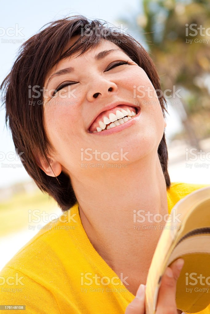 Woman Laughing and Reading royalty-free stock photo
