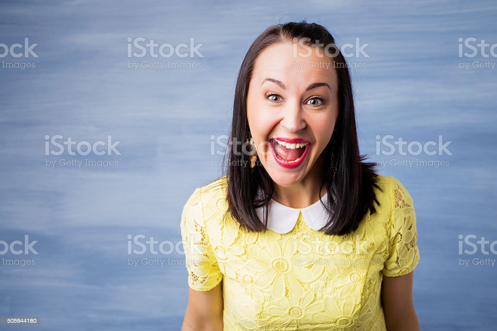 Woman laughing hysterically stock photo