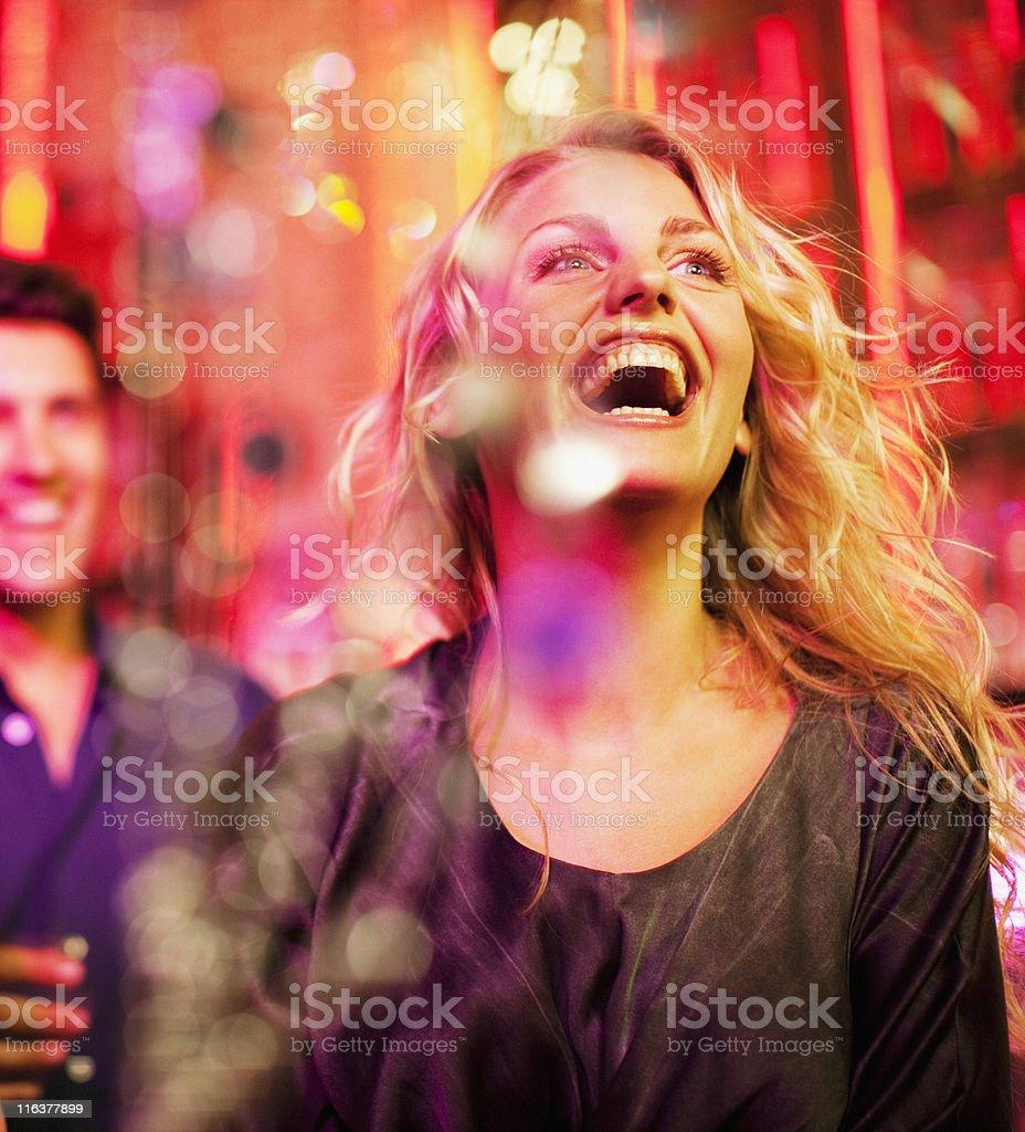 Woman laughing in nightclub royalty-free stock photo