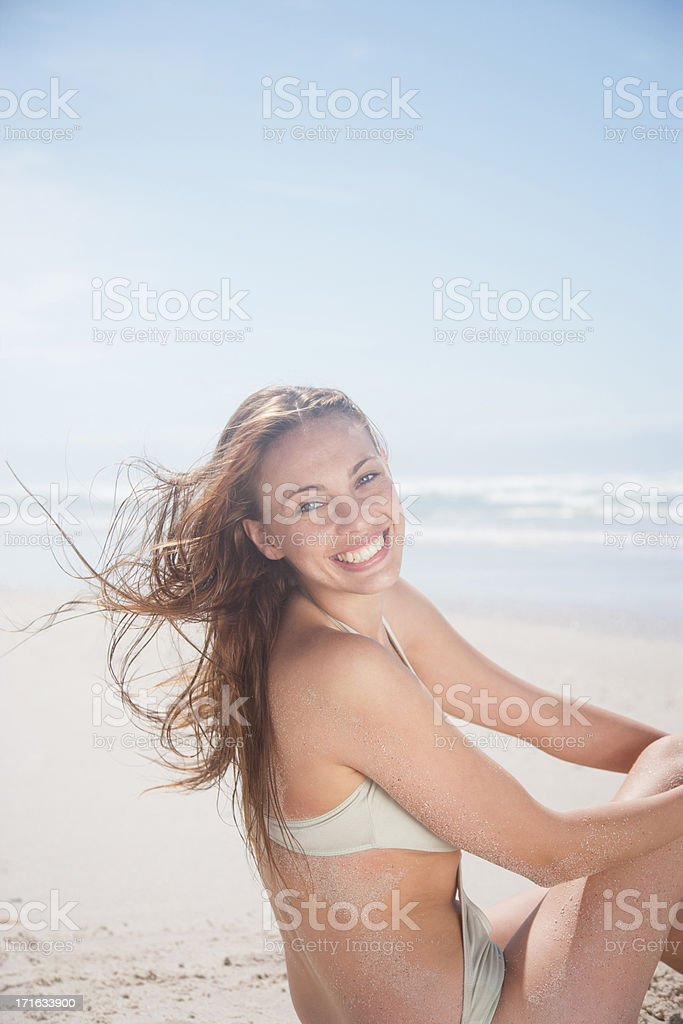 Woman laughing on beach stock photo