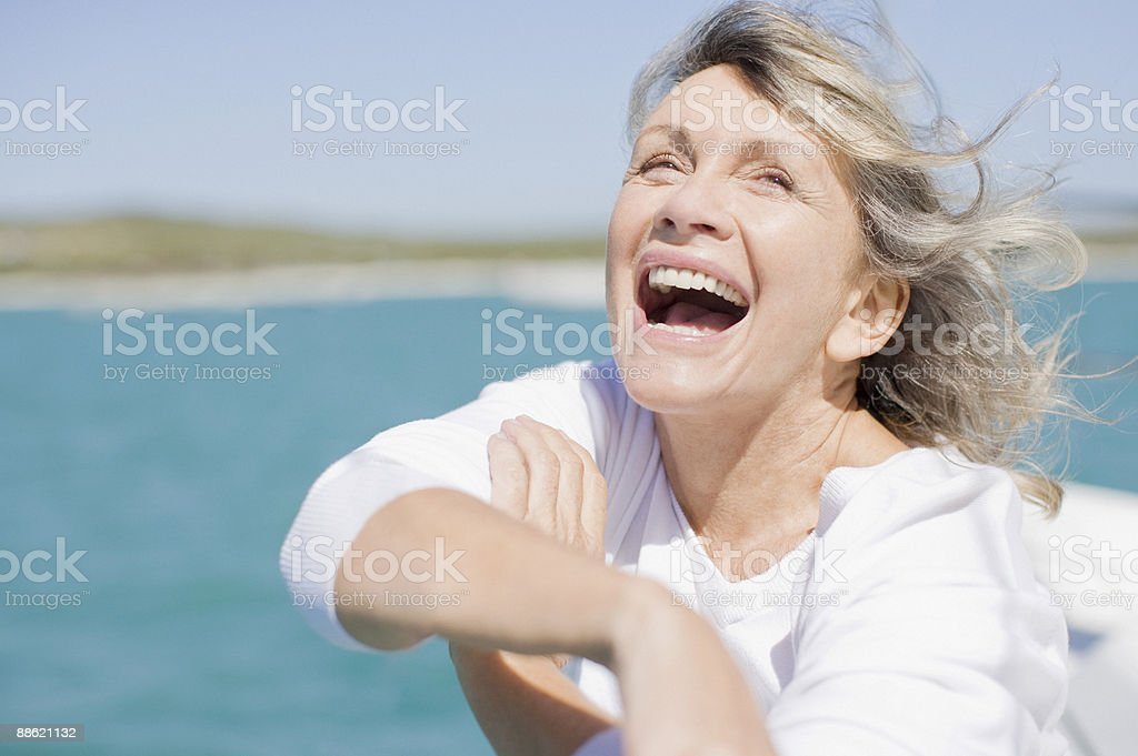 Woman laughing on deck of boat royalty-free stock photo