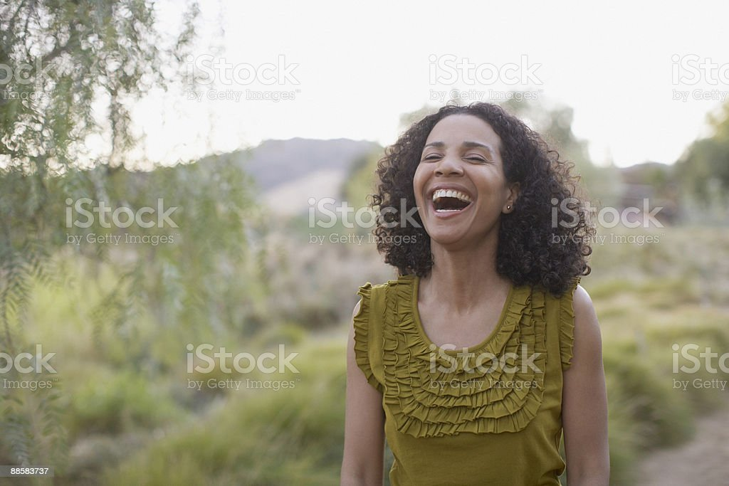 Woman laughing outdoors royalty-free stock photo