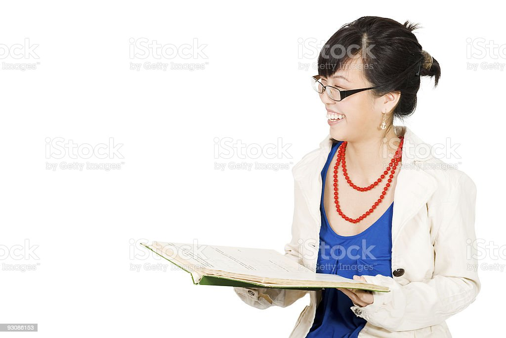 Woman laughing while reading royalty-free stock photo