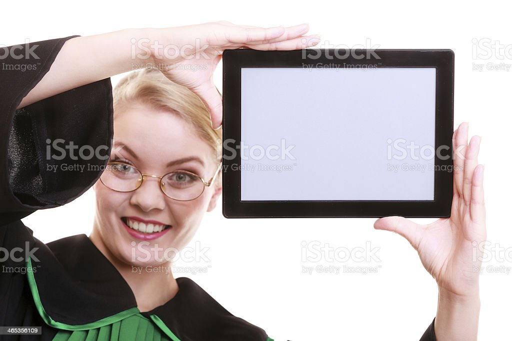 Woman lawyer attorney in classic polish gown holds tablet blank royalty-free stock photo