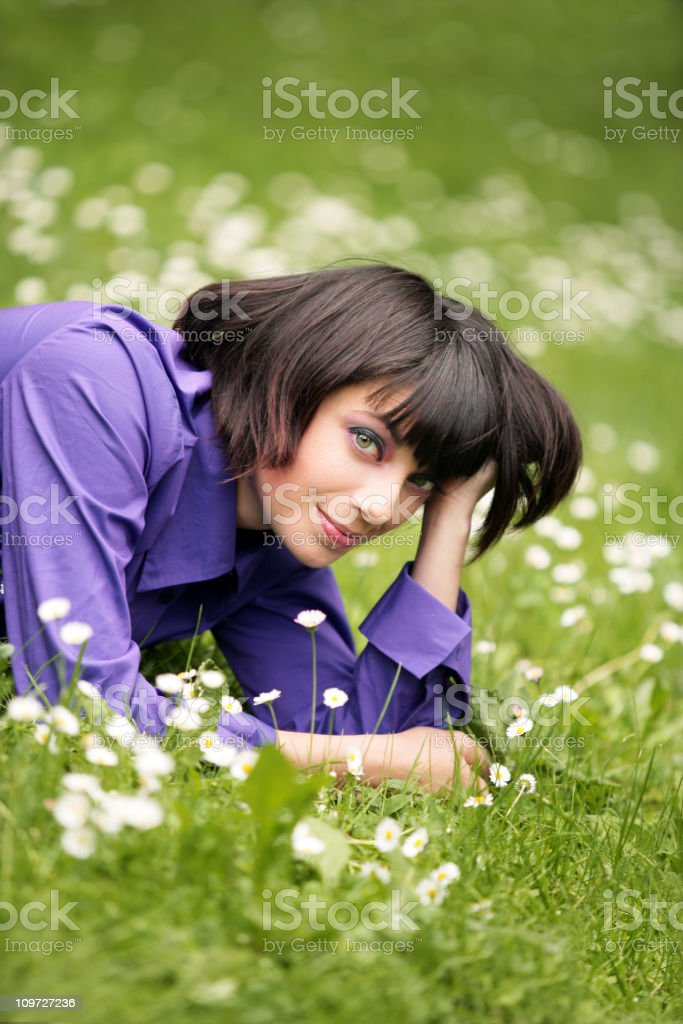 Woman laying in a meadow royalty-free stock photo