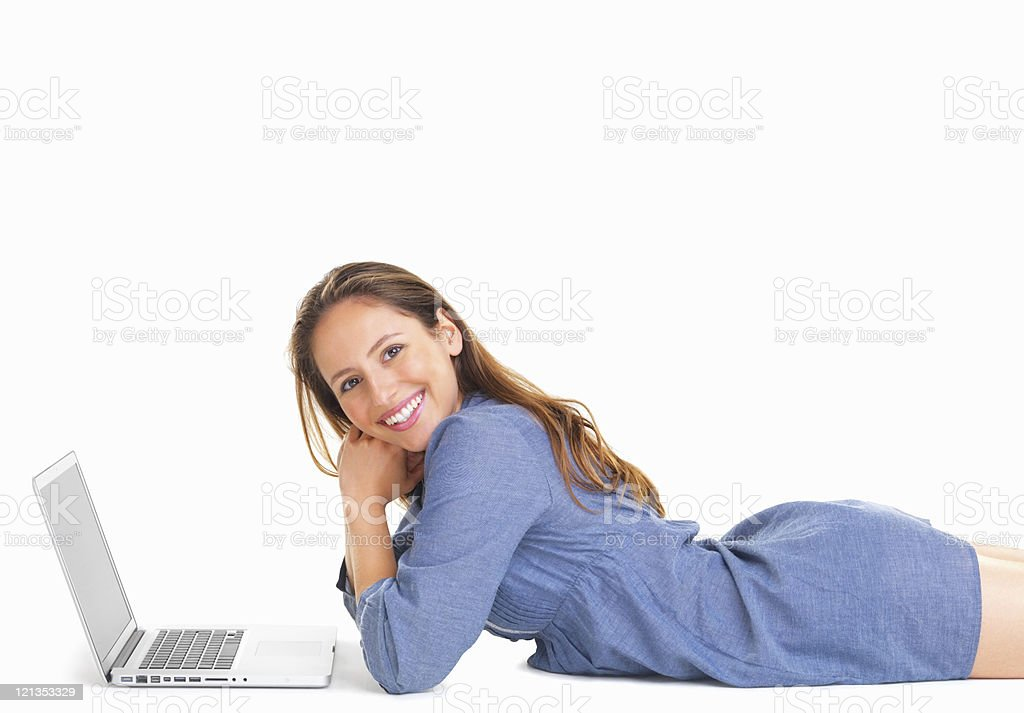 Woman laying in front of laptop royalty-free stock photo