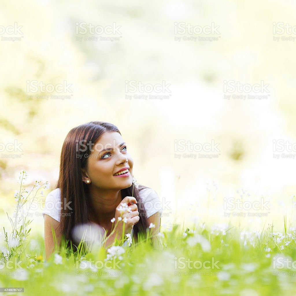 Woman laying in sunny spring park royalty-free stock photo