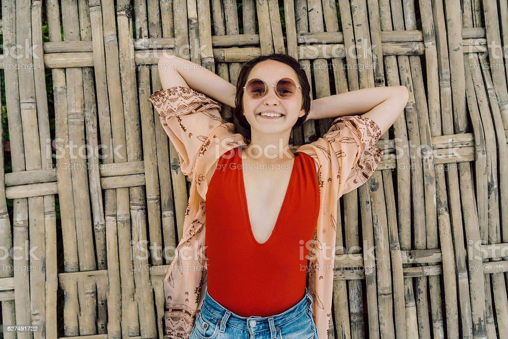Woman laying on bamboo bridge stock photo