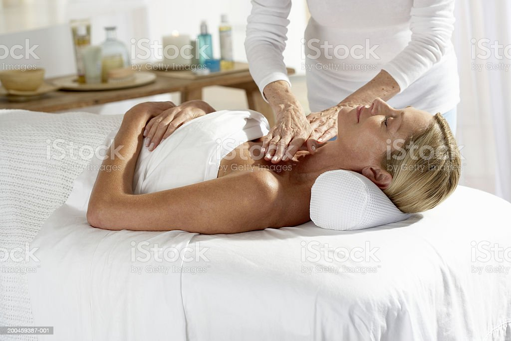 Woman laying on table having a massage royalty-free stock photo