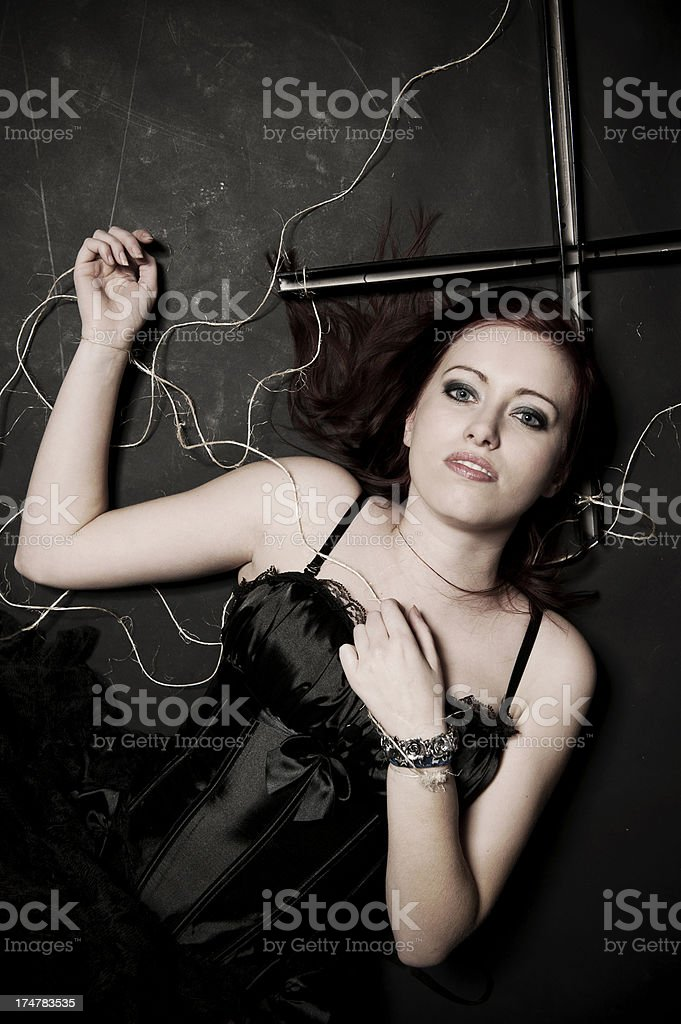 Woman laying on the ground royalty-free stock photo