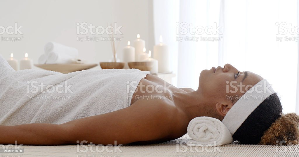 Woman Lays Down On The Massage Desk stock photo