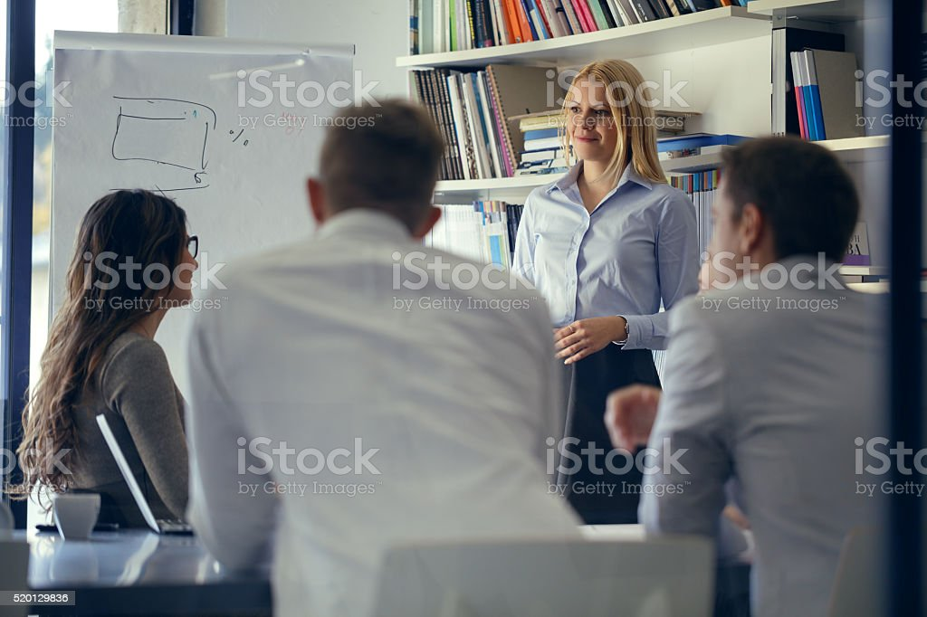 Woman leading a meeting stock photo