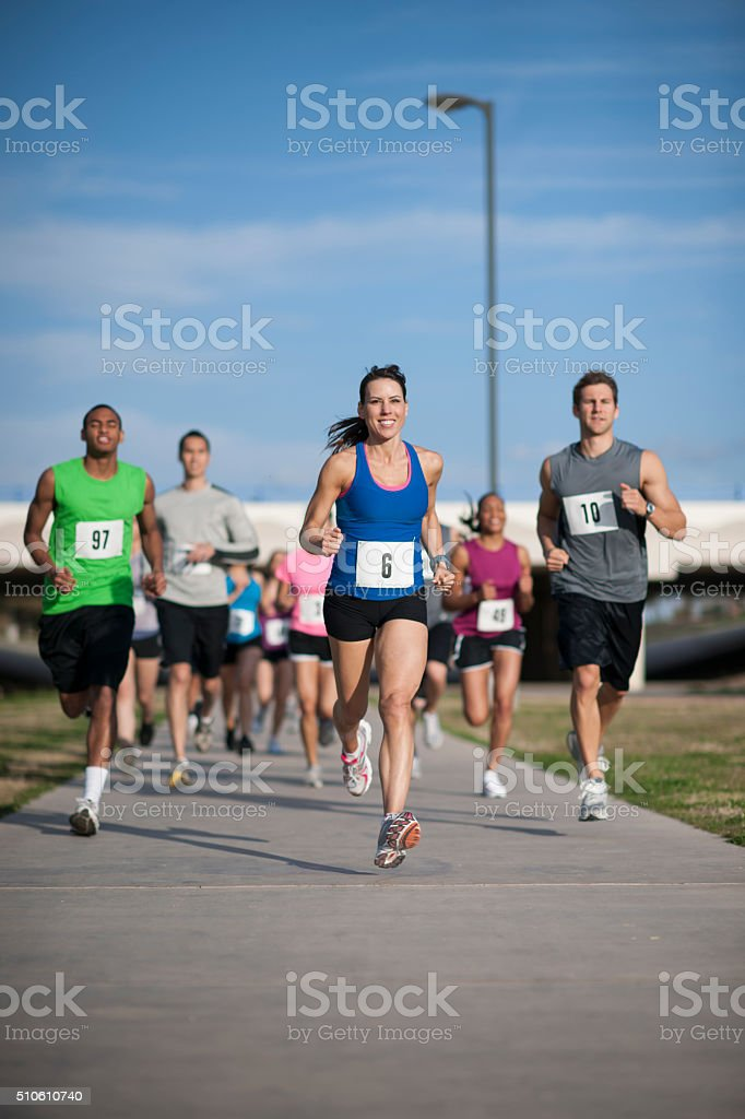 Woman Leading a Race stock photo