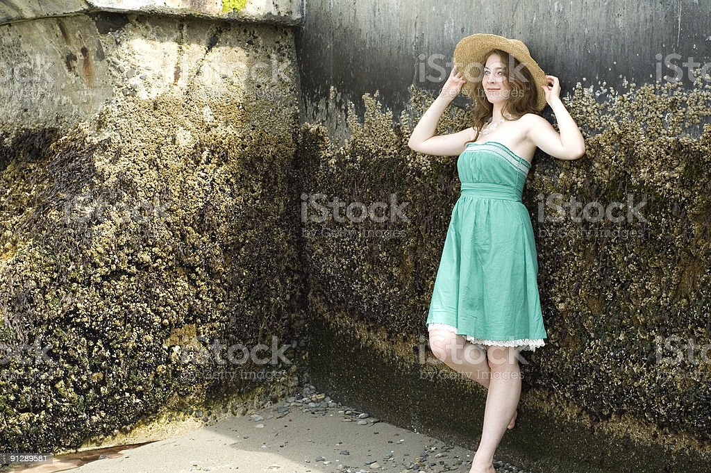 Woman Leaning Against Seawall stock photo