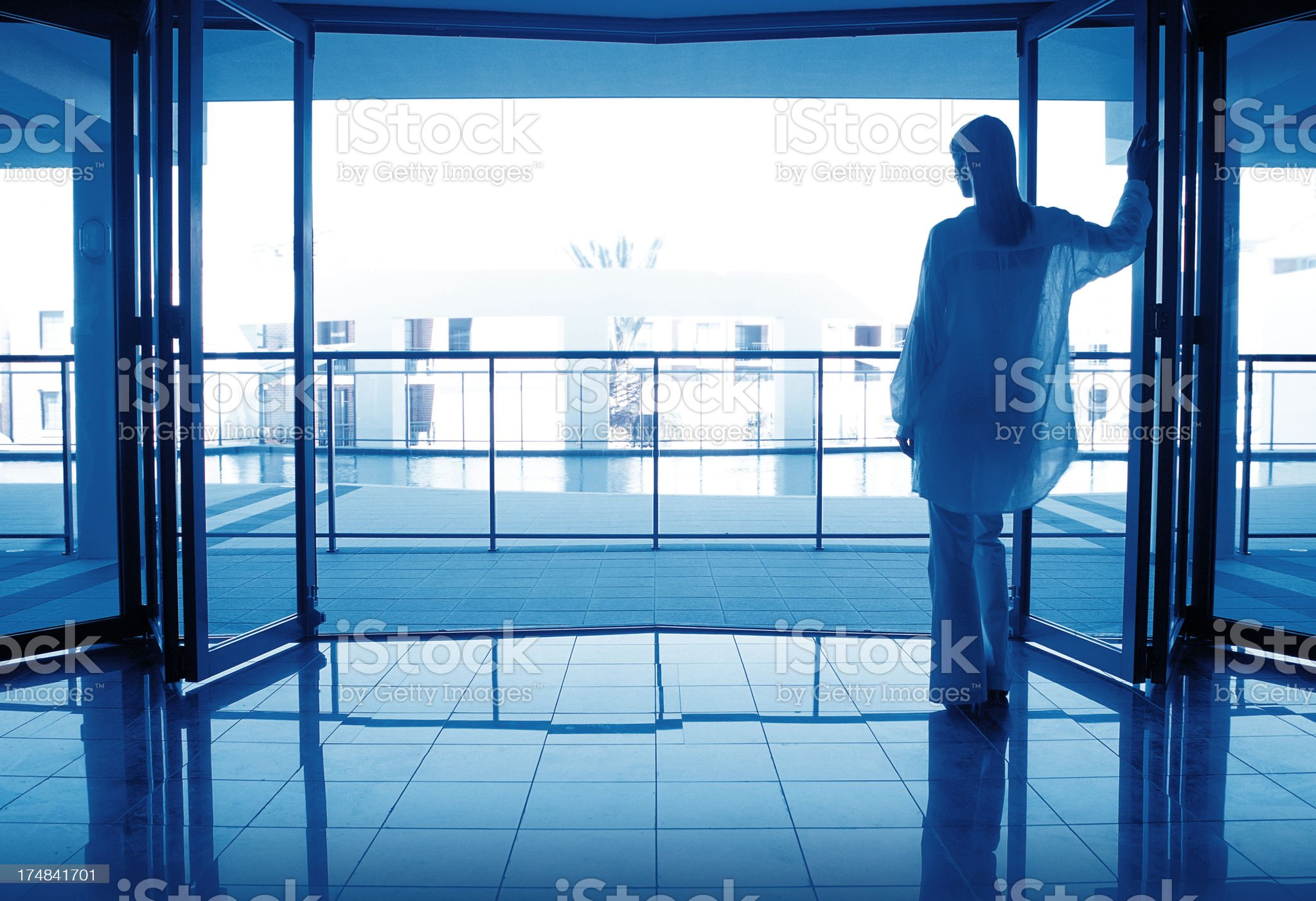 Woman leaning in doorway of luxury apartment. royalty-free stock photo