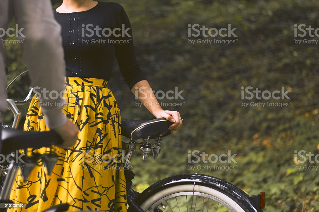 Woman leaning on a bicycle stock photo