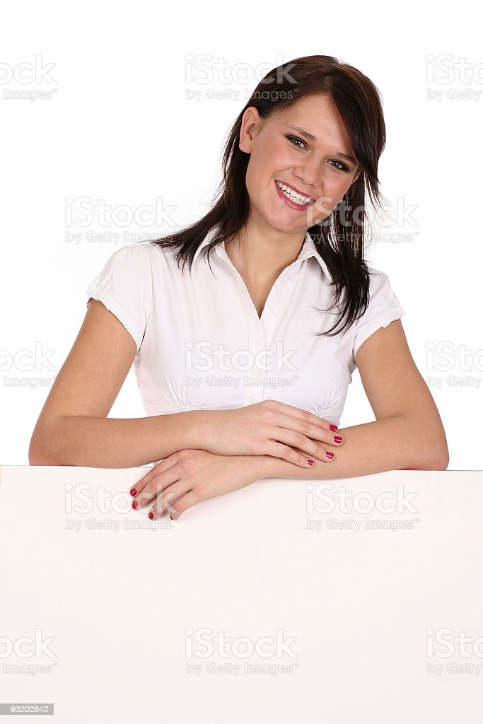 Woman leaning on a billboard royalty-free stock photo