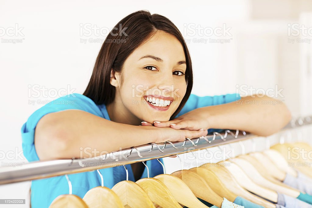 Woman Leaning On Clothes Rail royalty-free stock photo