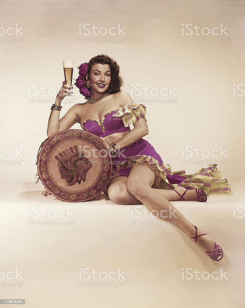 Woman leaning on cushion and holding beer glass  stock photo