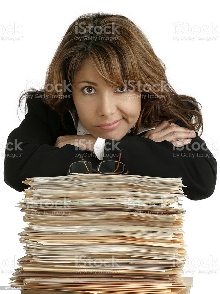 Woman Leaning on Stack of Paperwork royalty-free stock photo