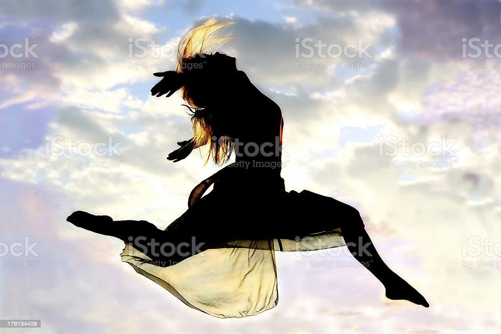 Woman Leaping through the Air royalty-free stock photo