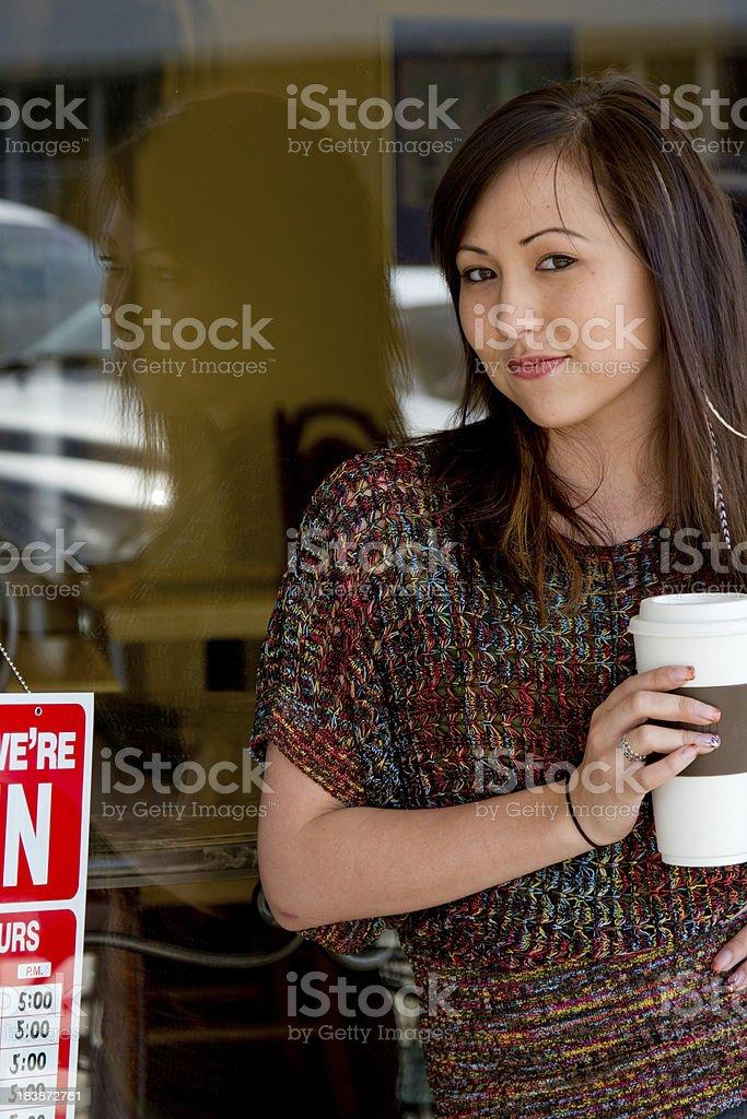 Woman leaving  Coffee Shop royalty-free stock photo