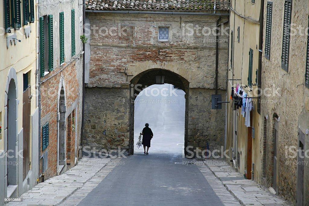 Woman leaving Sarteano - Italy royalty-free stock photo