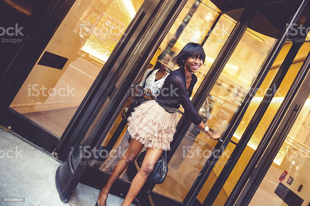Woman leaving the hotel stock photo