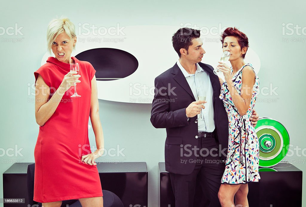 Woman left out from conversation at cocktail party royalty-free stock photo