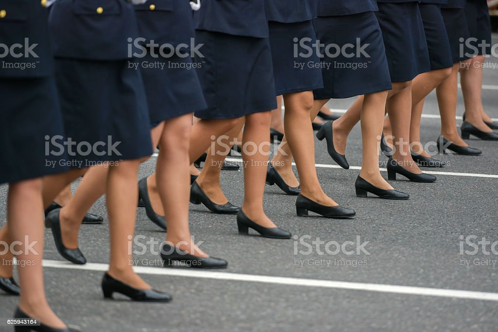 Woman legs in a row stock photo