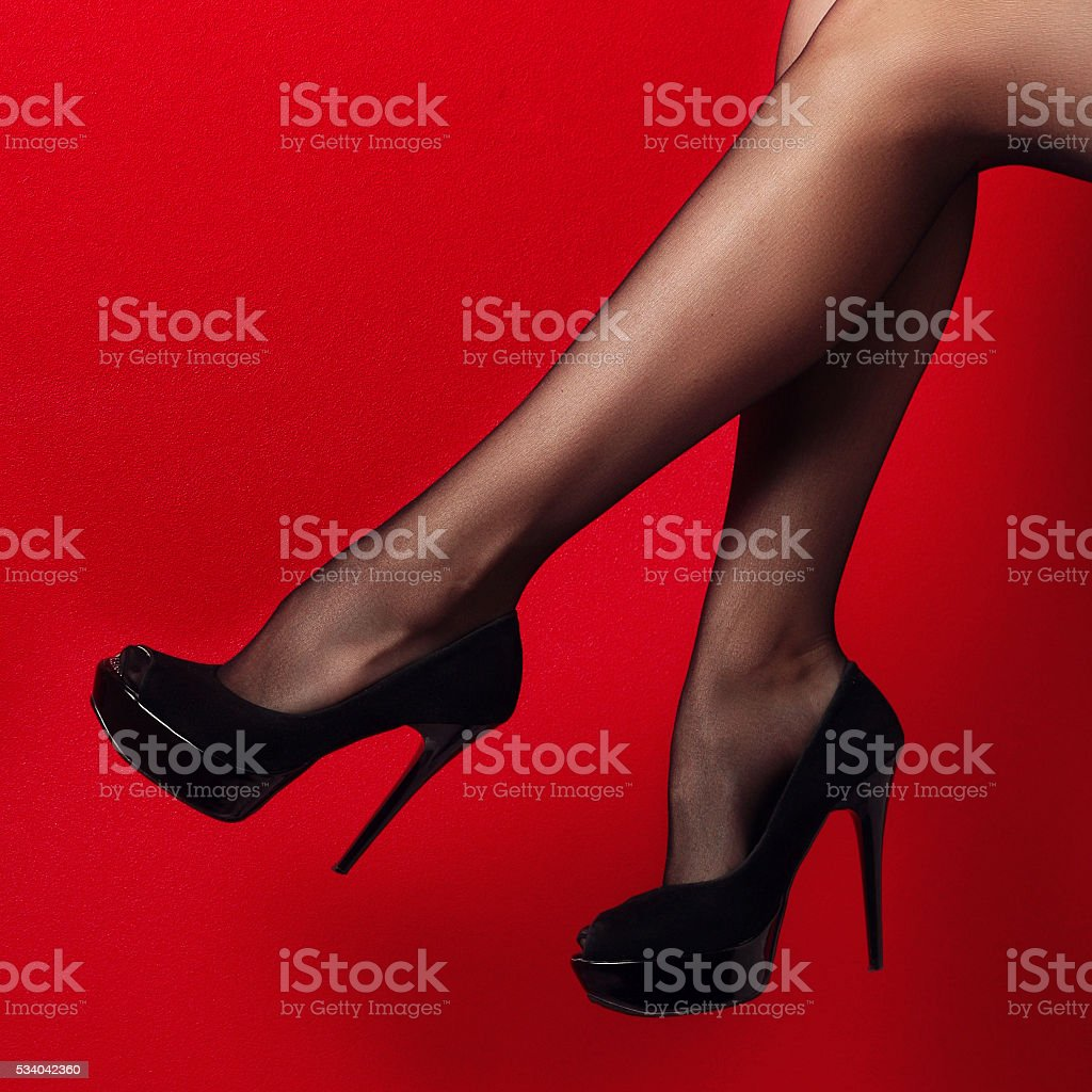 woman legs in high heel shoes outdoor shot stock photo
