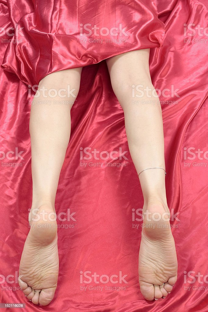 Woman  legs isolated over red royalty-free stock photo