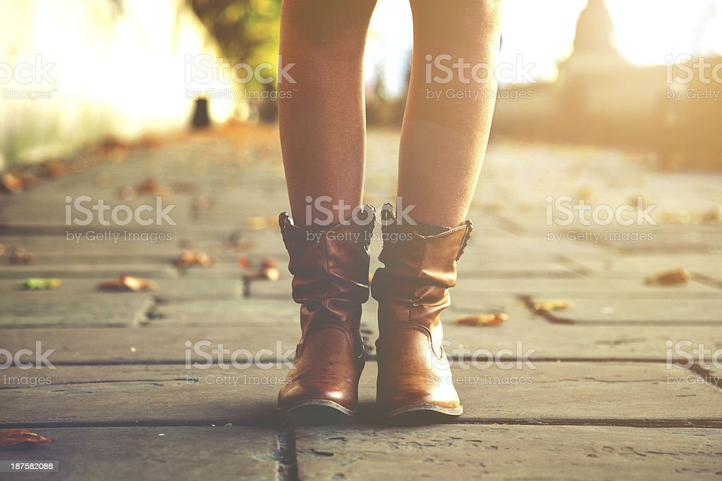 Woman legs on walkaway royalty-free stock photo
