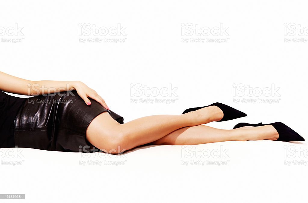 Woman legs sexy black heels, Isolated on white. stock photo