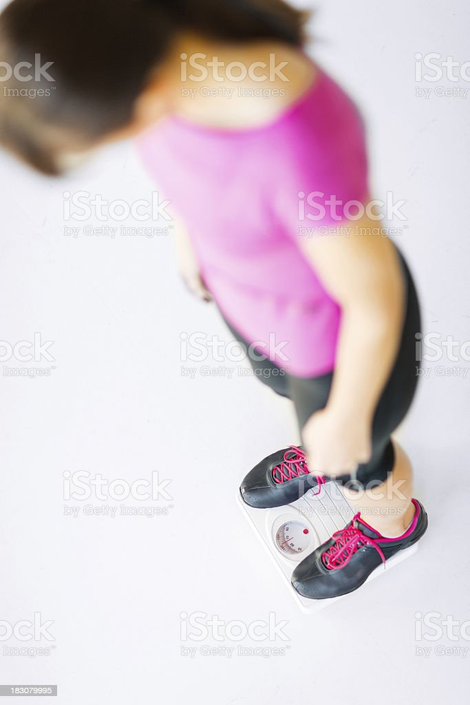 woman legs standing on scales royalty-free stock photo