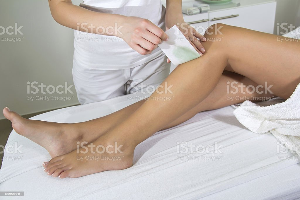 Woman Legs Waxed In Spa stock photo