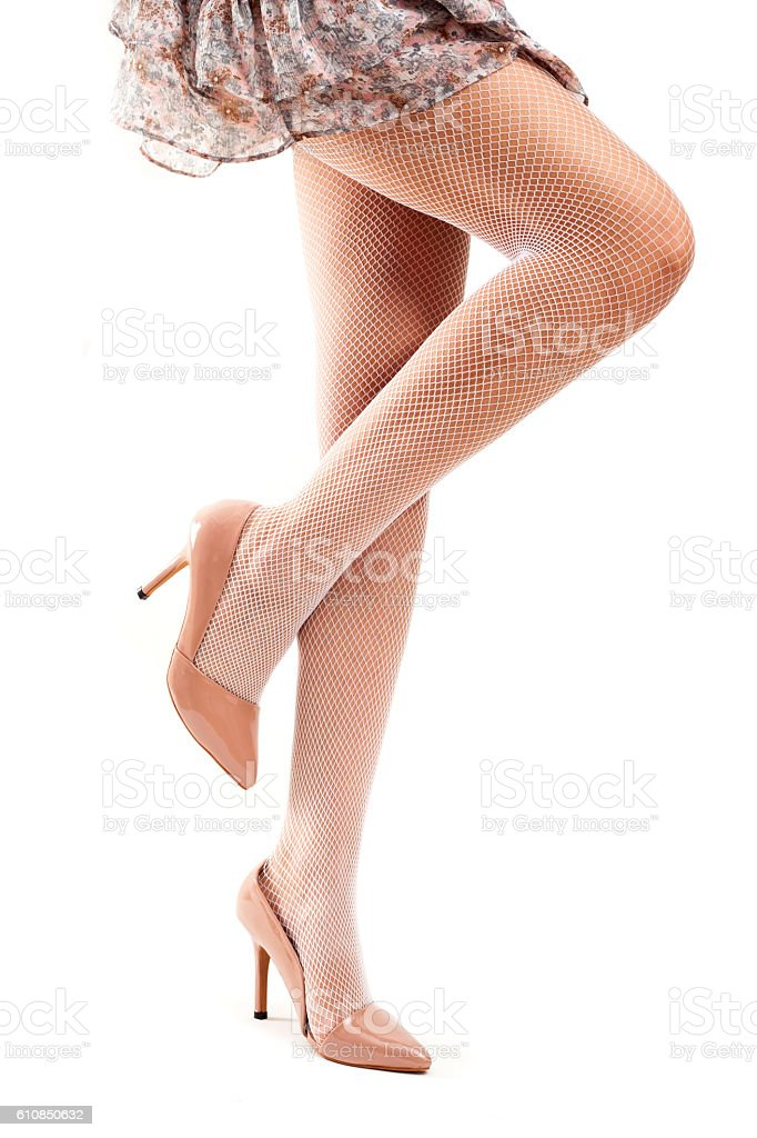 Woman legs wearing high heels  on white background stock photo