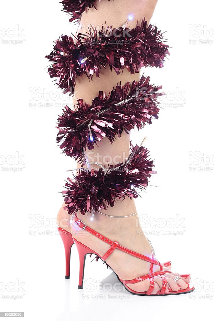 Woman Legs with decorations  heels stock photo