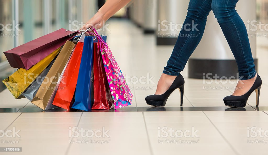 Woman legs with shopping bags stock photo