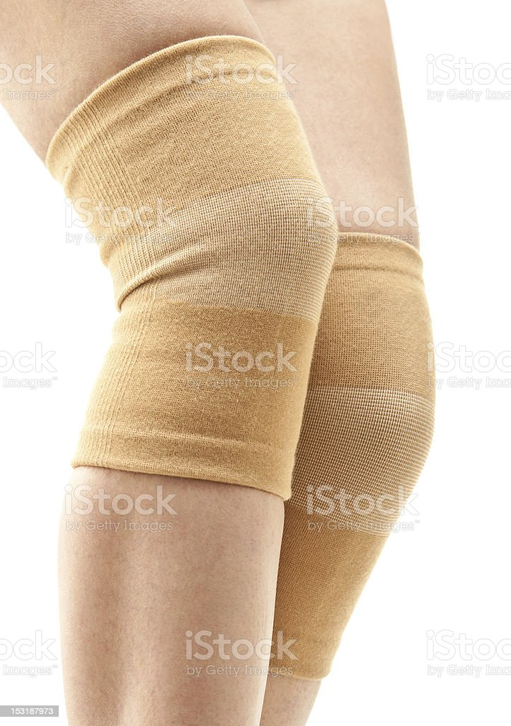 Woman legs with two compression knee braces stock photo