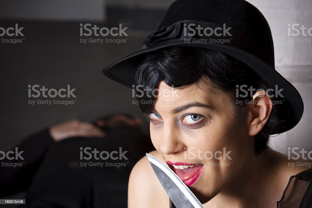 Woman Licking Her Knife After Murdering A Man stock photo