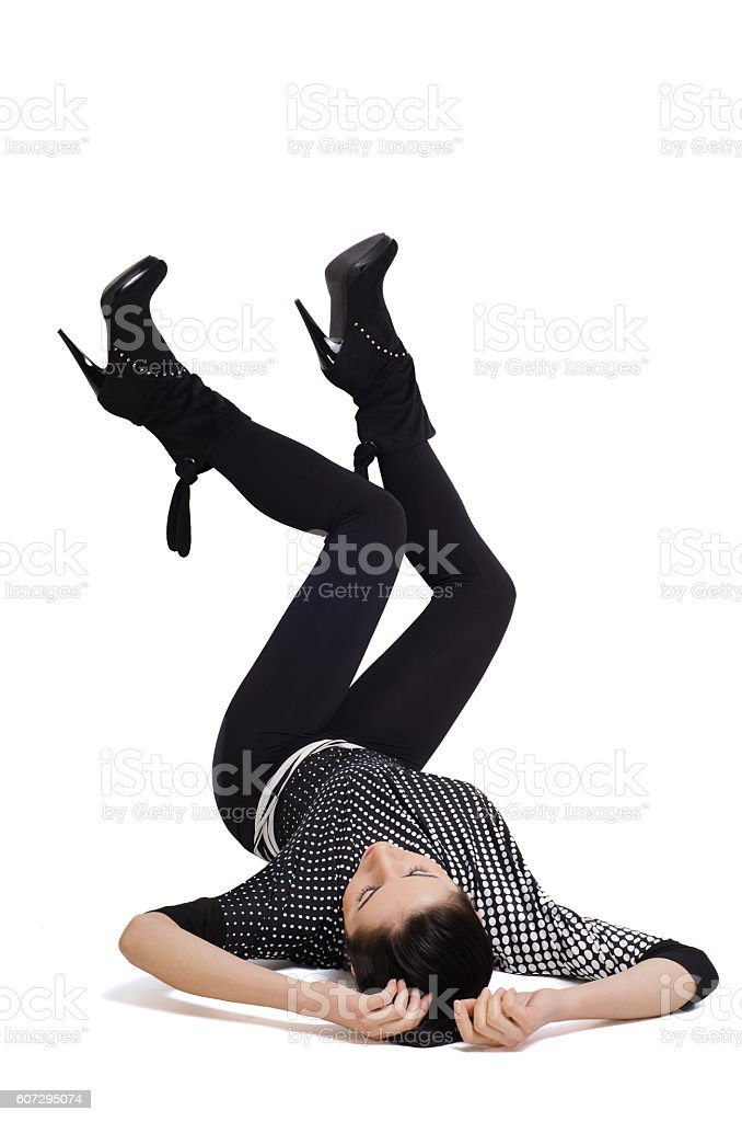 Woman lies on her back with  feet raised stock photo