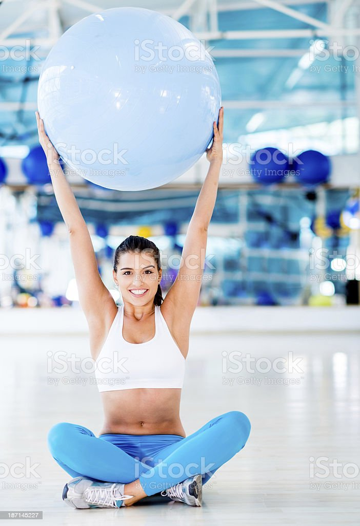 Woman lifting a fitness ball royalty-free stock photo