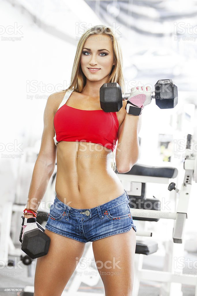 Woman lifting dumbbells royalty-free stock photo
